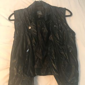 Black vest. Leather but ( not real )